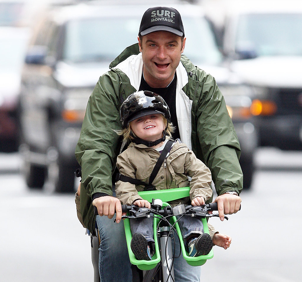 Liev Schreiber riding a bike with Samuel.