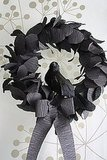 This raven wreath from the site Katydid and Kid has a Gothic sophistication, but still feels lighthearted and crafty with black crepe paper. Source: Katydid and Kid