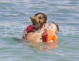 Gisele gave Ben a big hug in the water.