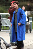 Shia wore a coat under his blue robe.