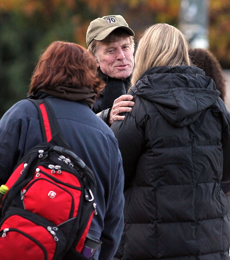 Robert Redford hugged a friend on set.