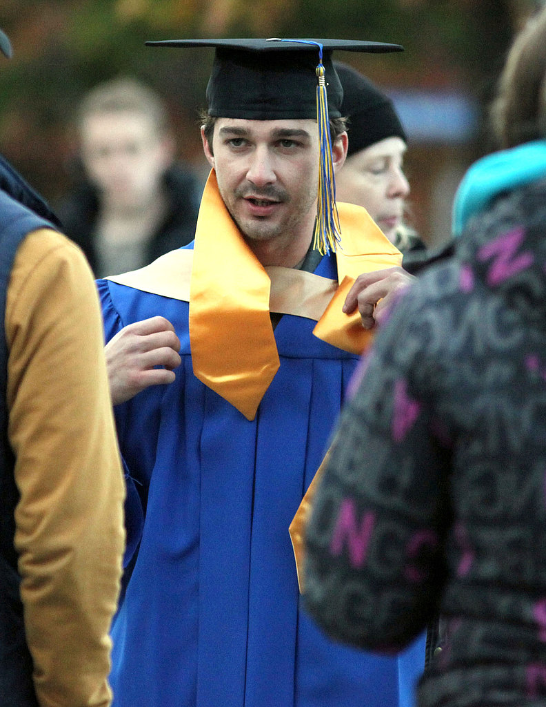 Shia prepped to accept his diploma in traditional graduation gear.