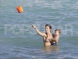Gisele tossed the floaties to the shore.