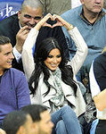 Supporting Her Man at a Nets vs. Mavericks Game