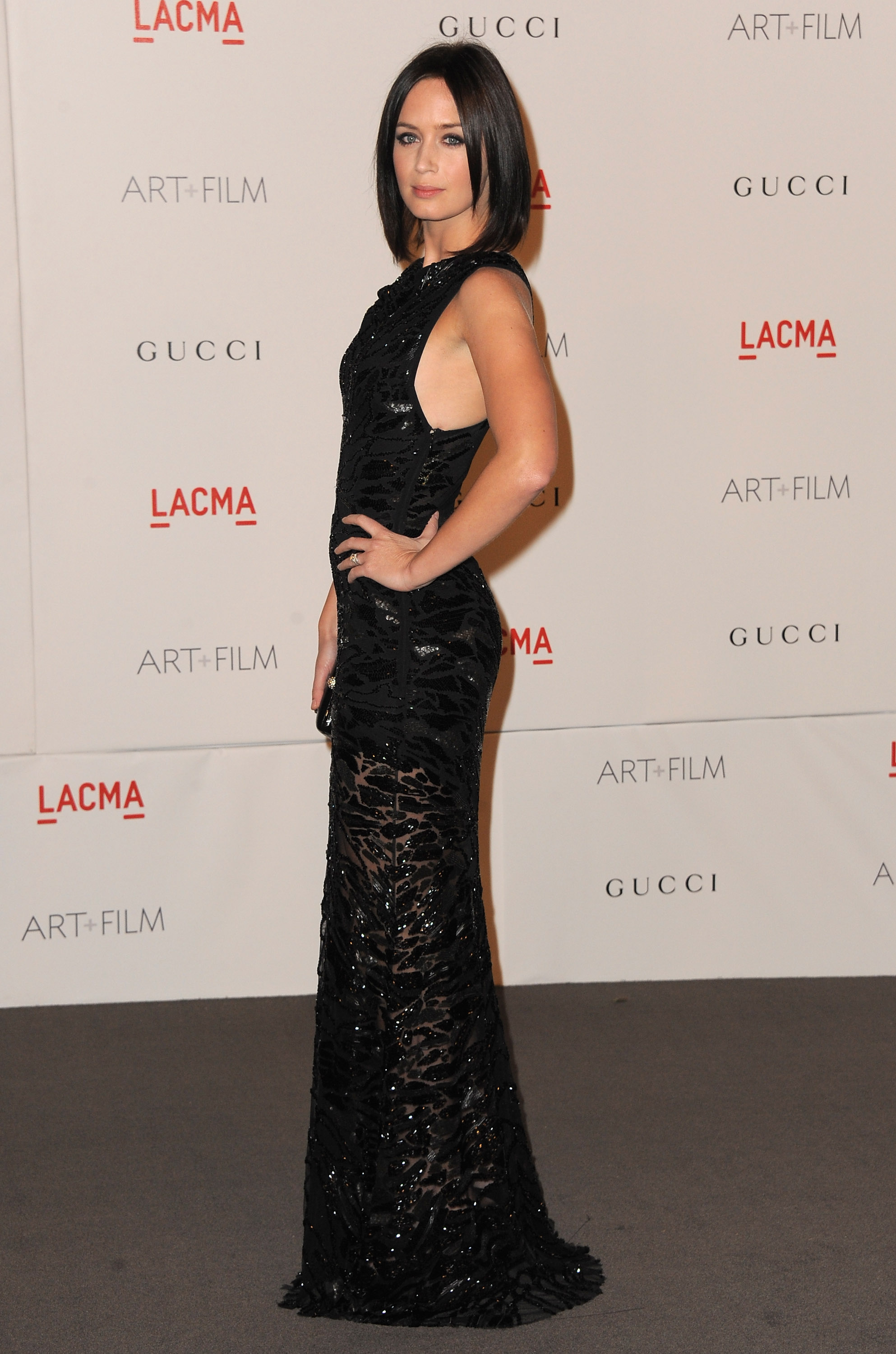 Emily Blunt in a sheer black dress.