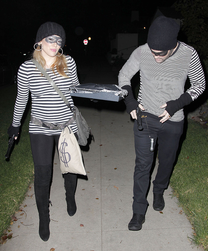 Hilary Duff and Mike Comrie had some props on hand for their Halloween costumes.