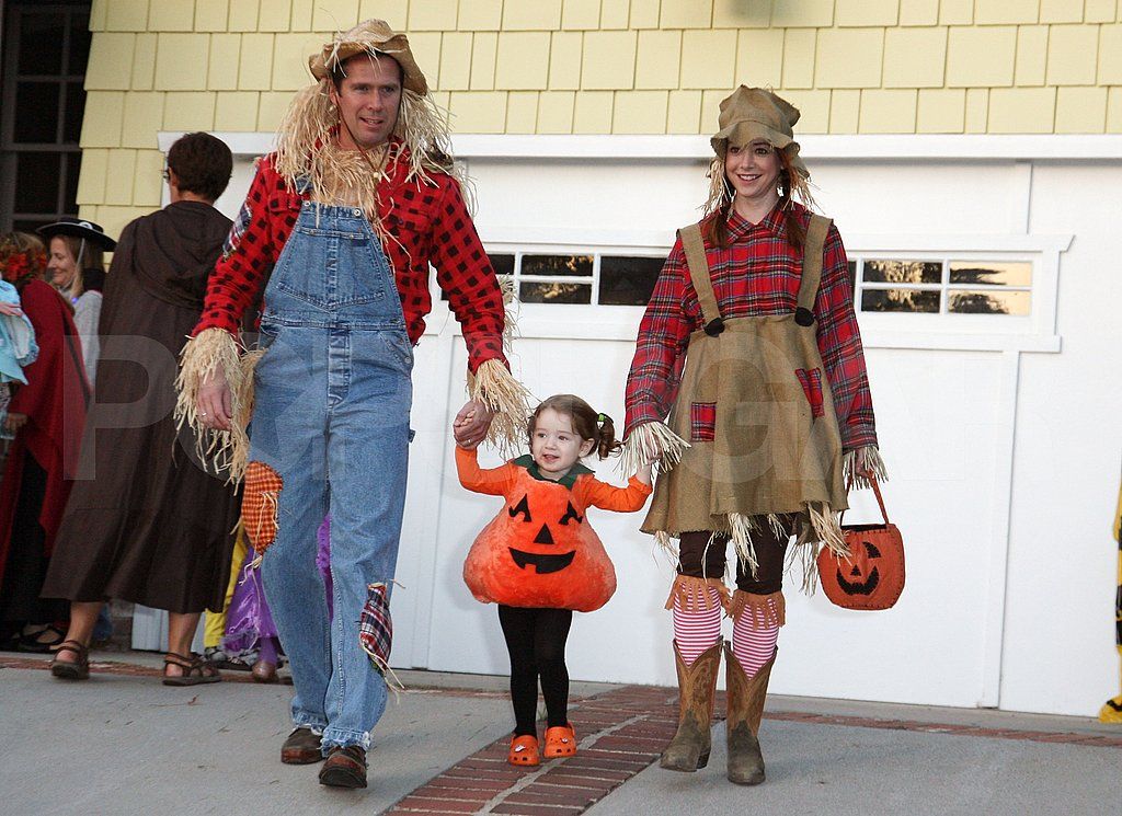 Alyson Hannigan and Alexis Denisof took out little pumpkin Satyana for Halloween in 2011.