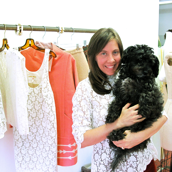 Lauren poses in her studio with her dog, Gertie.