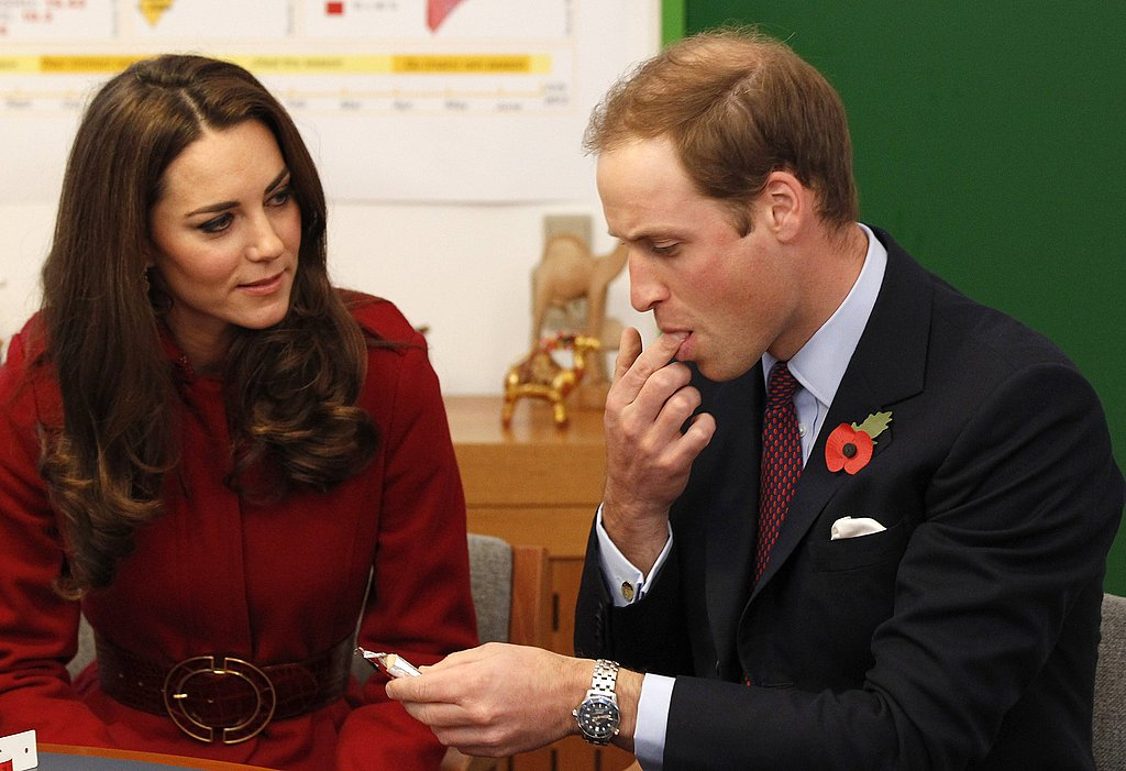 Prince William tries some vitamin paste.