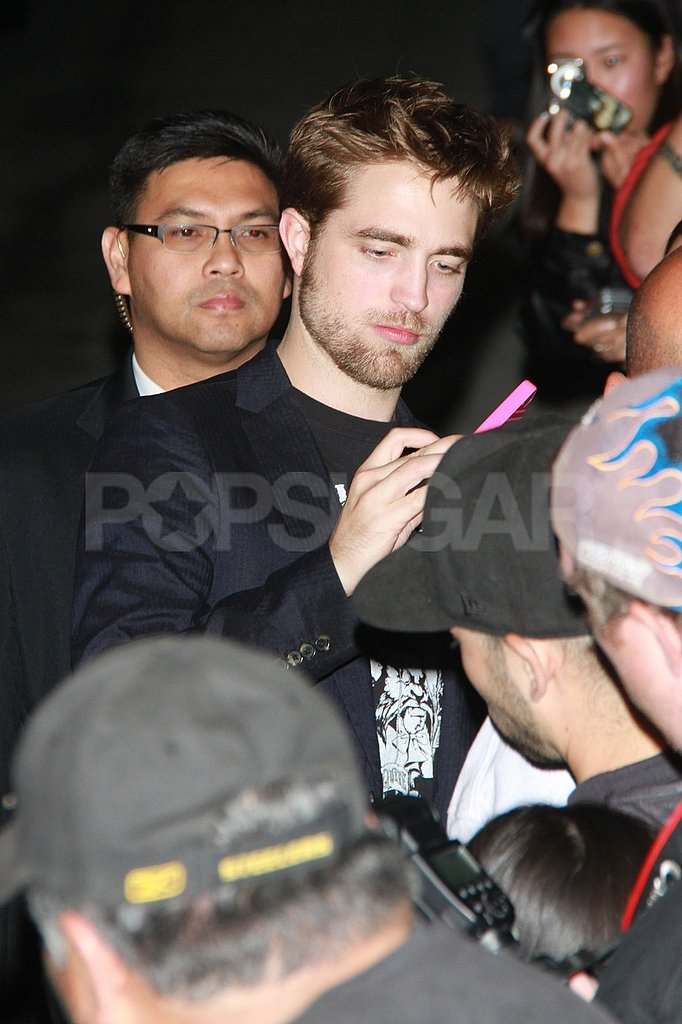 Robert Pattinson was surrounded by adoring fans.