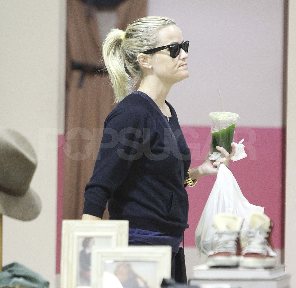 Reese Witherspoon with green drink in Beverly Hills.