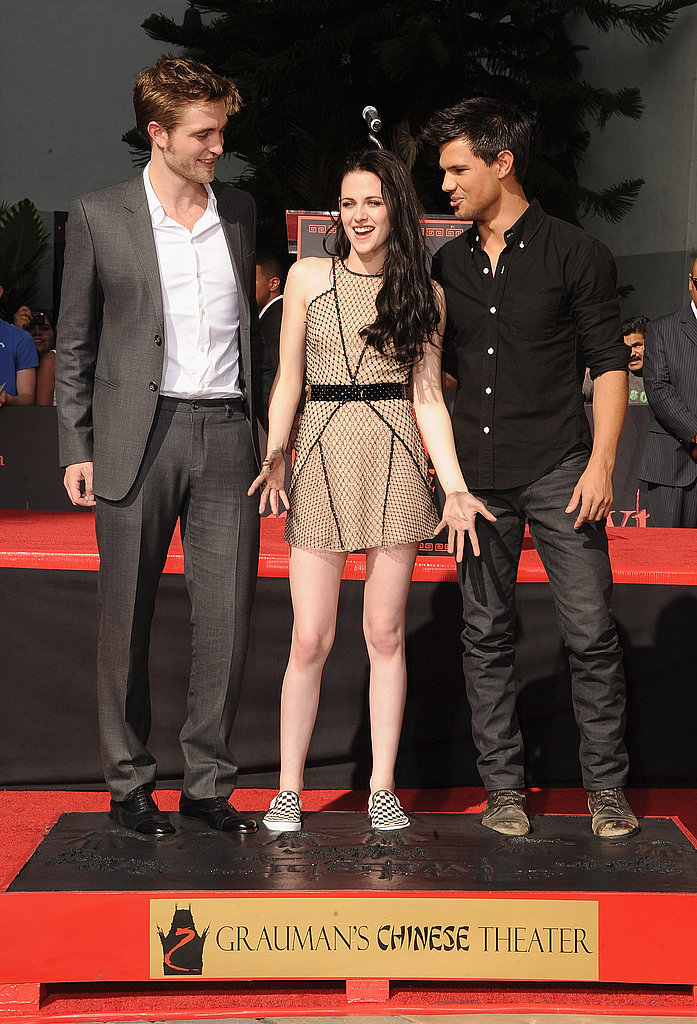 Robert Pattinson turned his feet in toward Kristen Stewart's in wet cement.