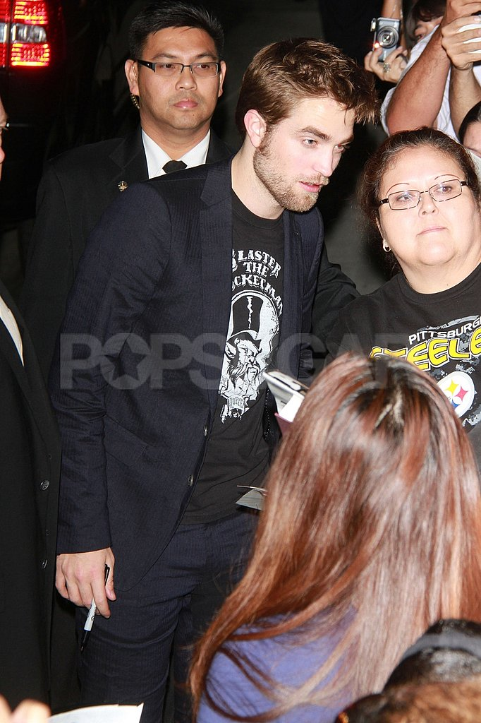 Robert Pattinson surveyed the scene of fans in LA.