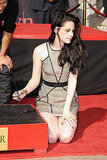 Kristen Stewart signed her name in front of Grauman's Chinese Theater.
