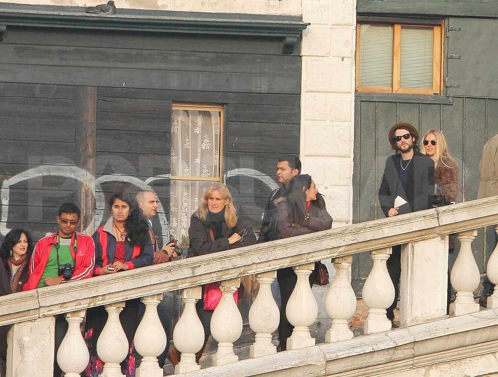 Sienna Miller and Tom Sturridge walked to St. Peter's Square.