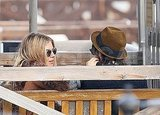 Sienna Miller brushed Tom Sturridge's hair out of his face.