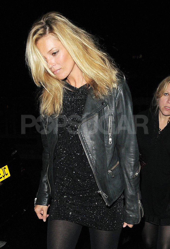 Kate Moss layered a leather jacket over a sparkly dress.