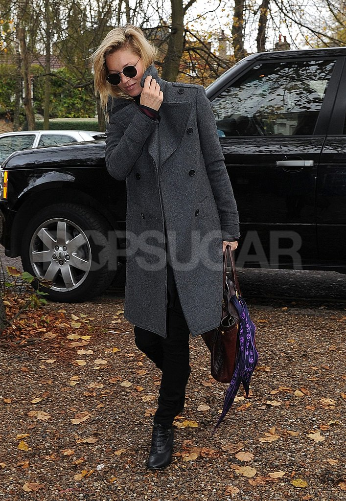Kate Moss wore a long, gray coat to visit the site of her future home.
