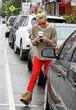 Kate Hudson paired her red jeans with red sunglasses.