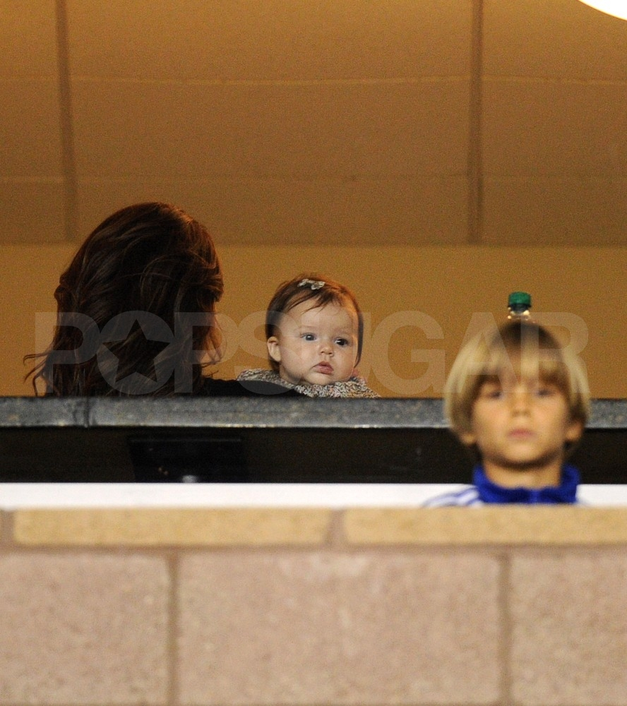 Romeo and Harper Beckham watched their dad's soccer game.