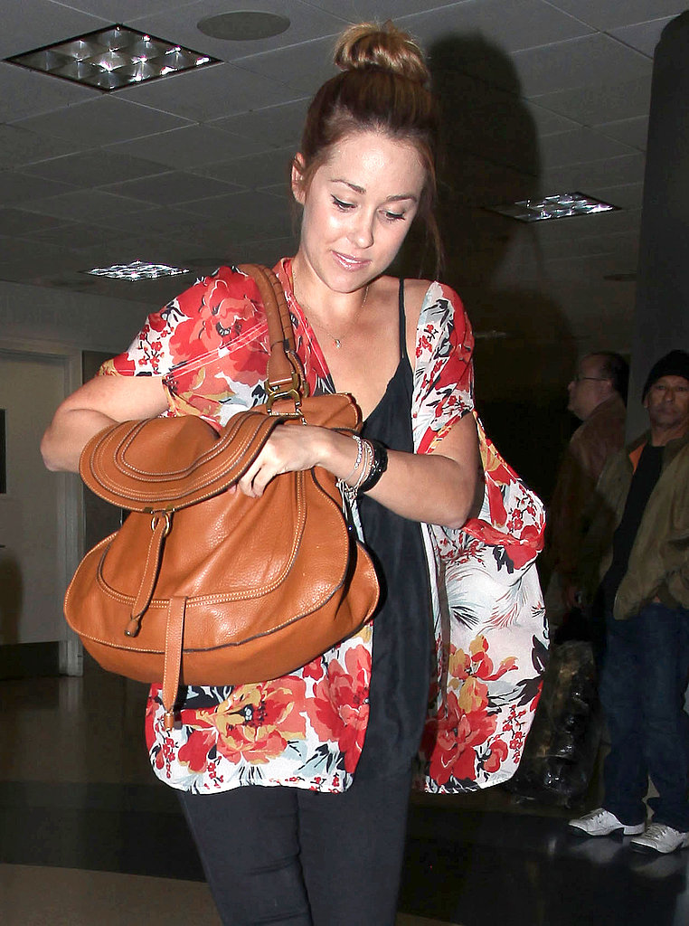 Lauren Conrad toted a leather bag.
