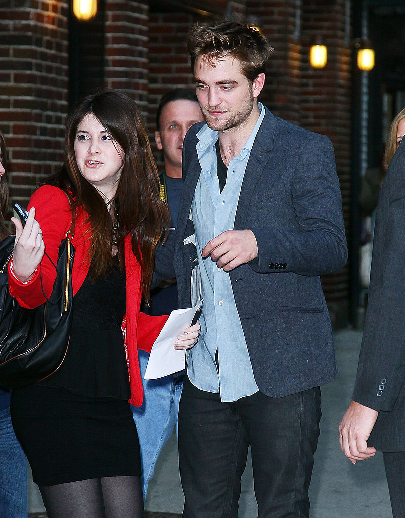 Rob stopped to sign an autograph for a fan.