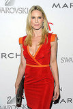 Stephanie March in an orange and red dress.