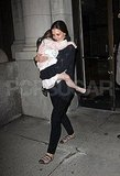 Suri Cruise wrapped herself around mom Katie Holmes.