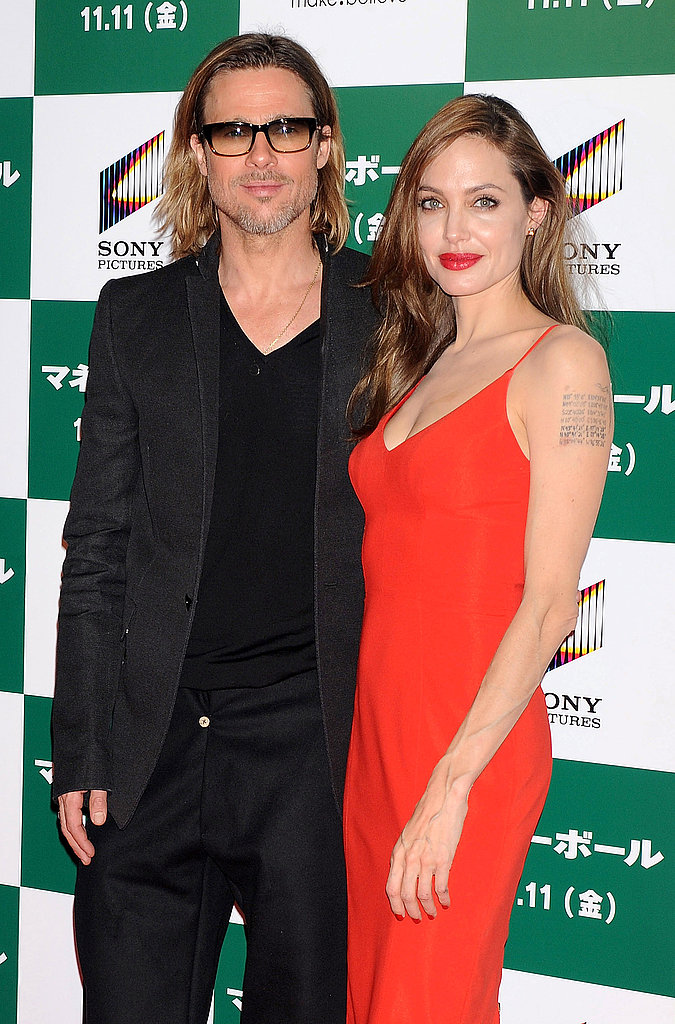 Brad Pitt and Angelina Jolie both took the red carpet in monotone looks.