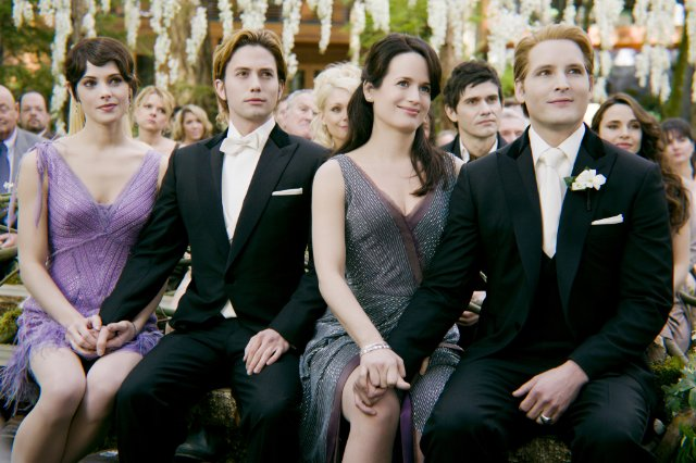 Alice, Jasper, Esme, and Carlisle held hands at Edward and Bella's wedding in Breaking Dawn Part 1.