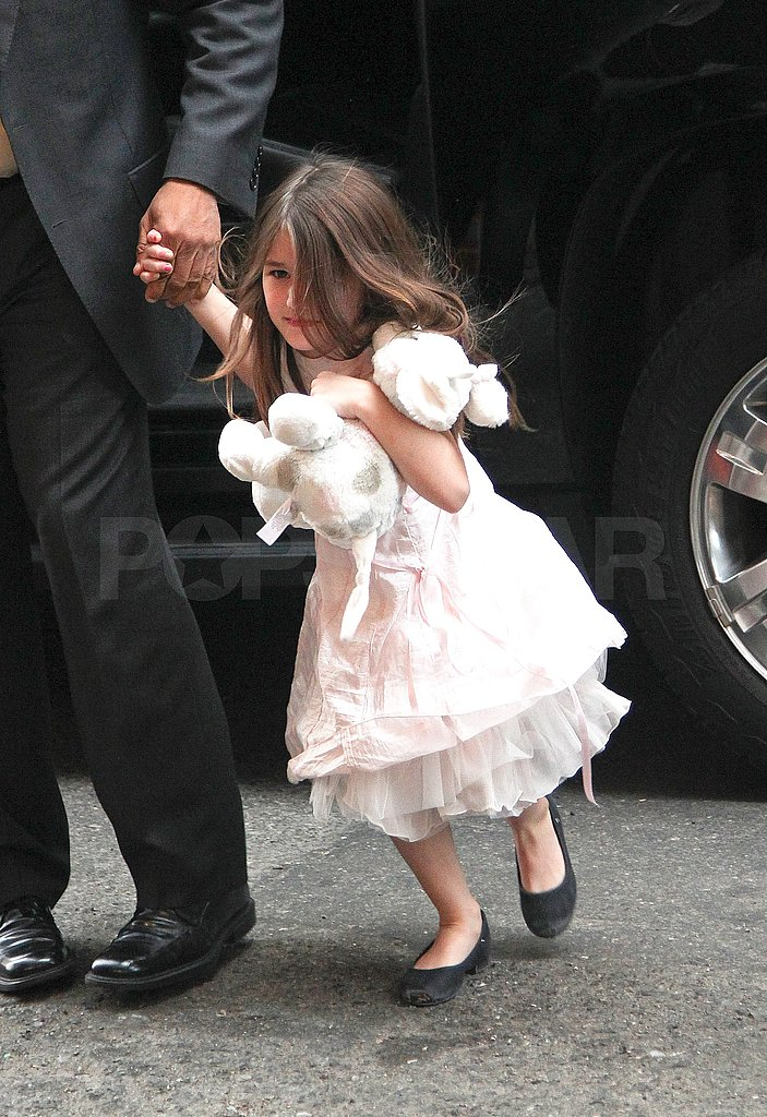 Suri Cruise arrived back at her NYC apartment with her nanny.