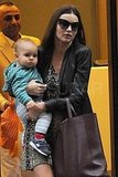 Miranda Kerr carried her son Flynn in NYC.