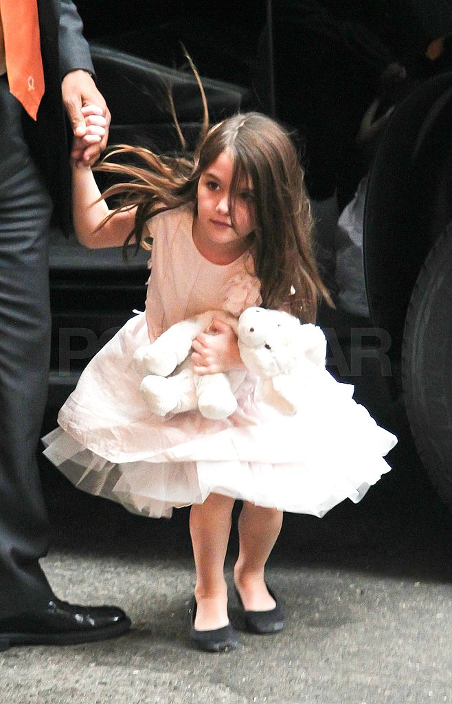 Suri Cruise held hands with her nanny in NYC.