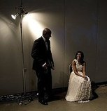 Reggie Love waits with Michelle Obama before she makes her grand entrance to an inaugural ball on January 20, 2009.