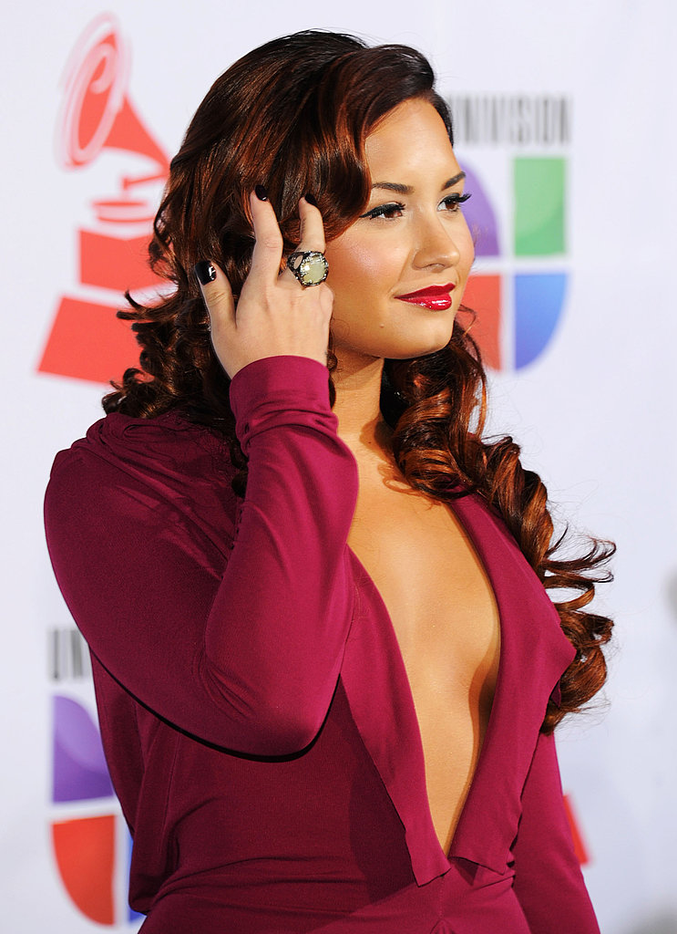 Demi Lovato showed off her plunging neckline.