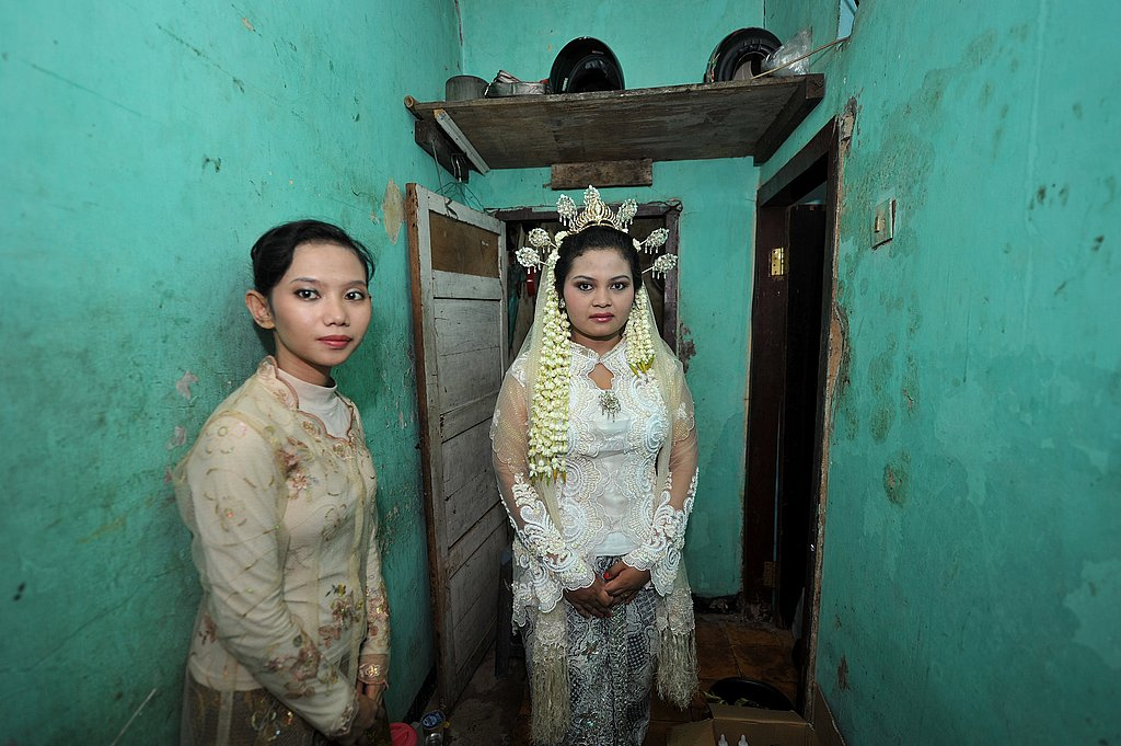 Indonesian bride Anita Sari, 19, waits for her wedding ceremony which was held at 11 o'clock in Jakarta on November 11, 2011.
