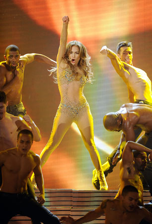 Jennifer Lopez performed in a flesh-colored bodysuit decorated with jewels.