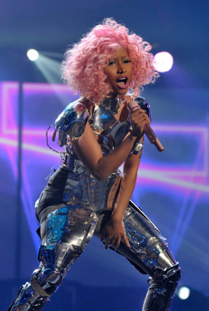 Nicki Minaj took to the American Music Awards stage with pink hair.