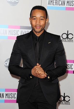 John Legend looked dapper in a black suit.