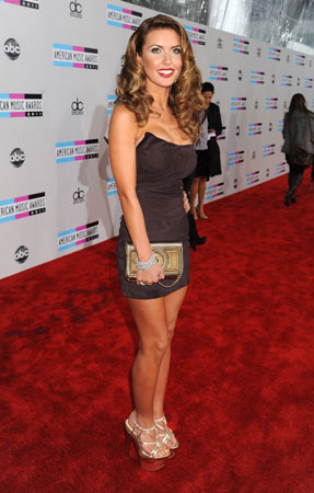 Audrina Patridge walked the red carpet in curls.