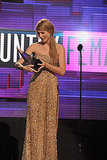 Taylor Swift cradled an American Music Award.
