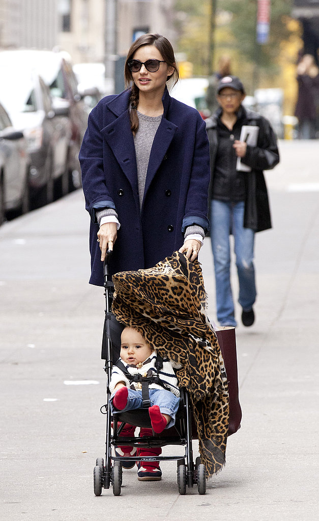 Flynn Bloom peeked out from behind a leopard-print blanket on a walk with Miranda Kerr.
