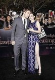 Robert Pattinson leaned in close to Kristen Stewart as she showed a flash of leg.