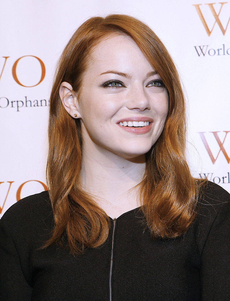 Emma Stone wore her hair in loose curls.