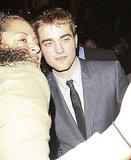 Robert Pattinson leaned in for a picture.