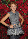 Blake Lively shared her killer smile in front of a wall of red roses.