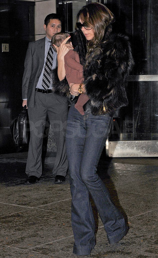 Victoria wore a black fur coat and jeans for travel.
