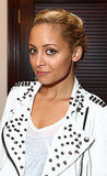 Nicole Richie in a white studded leather jacket.