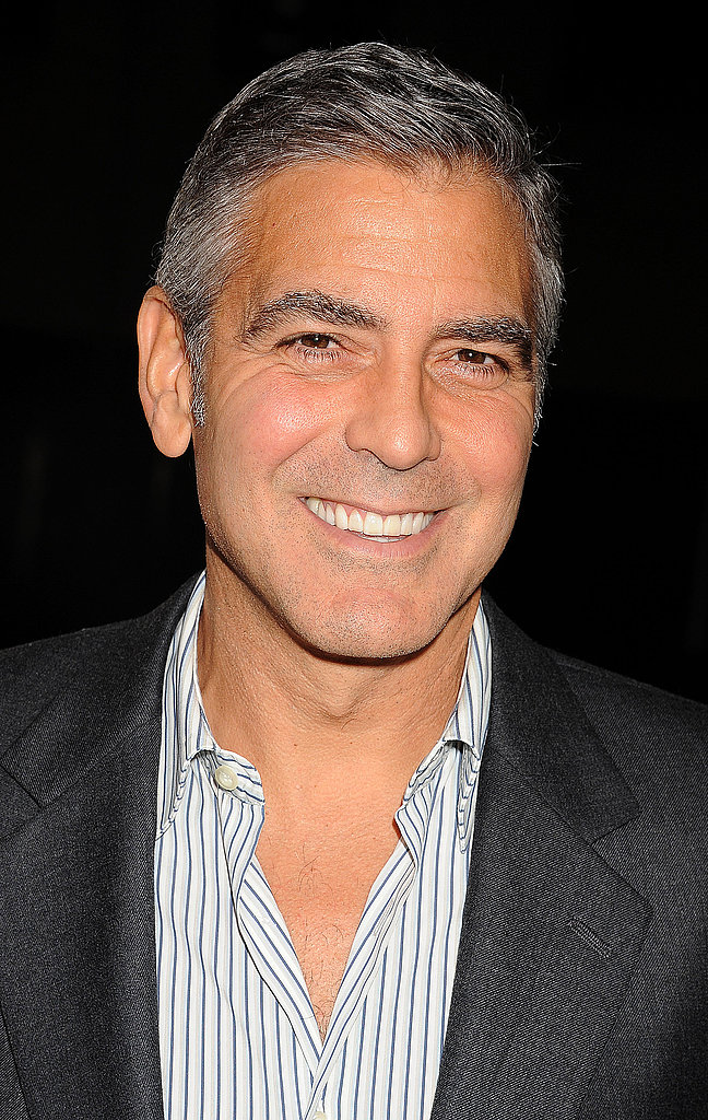 George Clooney gave a winning smile on the red carpet.
