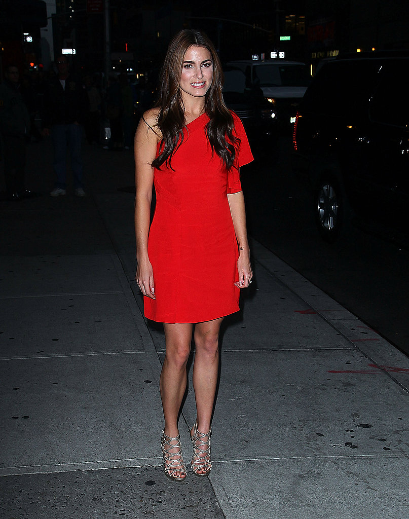 Nikki Reed in a red dress in NYC.